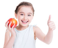 Portrait of cute little girl holding an apple. Stock Photos