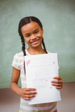 Portrait of cute little girl holding paper Royalty Free Stock Photo