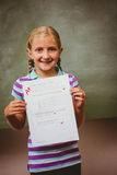 Portrait of cute little girl holding paper Royalty Free Stock Photography