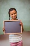 Portrait of cute little girl holding school slate Stock Image