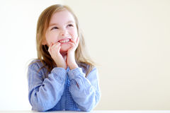 Portrait of a cute little girl at home royalty free stock image