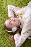 Portrait of cute little girl listening music royalty free stock photo