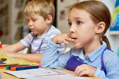Attentive Little Kids in Pre-School stock photo