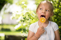 Portrait of Cute Little Girl with Lollipop Royalty Free Stock Photography