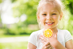 Portrait of Cute Little Girl with Lollipop Stock Image