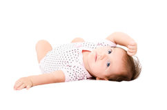 Portrait of a cute little girl lying on her back Stock Photo