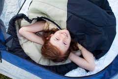 Portrait Of Cute Little Girl Lying In Tent Stock Photography