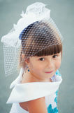 Portrait of a cute little girl in a magnificent white and blue dress Stock Image