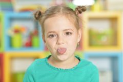 Portrait of a little girl making funny faces. Portrait of cute little girl making funny faces royalty free stock photos