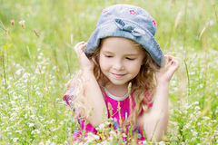 Portrait of a cute little girl on the meadow Stock Photo