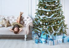 Portrait of a cute little girl in a modern interior royalty free stock images