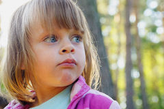 Portrait of cute little girl in nature Royalty Free Stock Photos