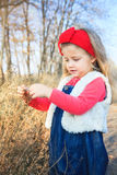 Portrait of a cute little girl on a nature. Royalty Free Stock Images