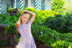 Portrait of a cute little girl. Outdoor portrait of a cute little girl playing in a garden on a nice sunny day Royalty Free Stock Photos