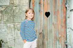 Portrait of a cute little girl. Outdoors Stock Photos