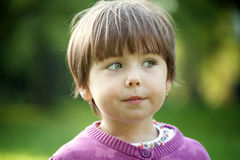 Portrait of a cute little girl outside royalty free stock images
