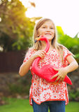 Portrait of cute little girl outside with pink flamingo Stock Photo