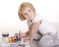 Portrait of cute little girl painting Royalty Free Stock Images