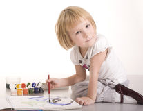 Portrait of cute little girl painting Royalty Free Stock Photo