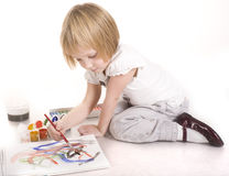 Portrait of cute little girl painting Royalty Free Stock Image