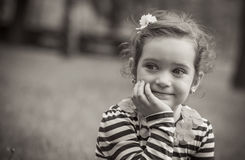Portrait of cute little girl in a park Royalty Free Stock Image