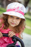 Portrait of cute little girl in a park Stock Images