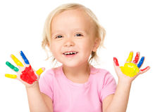 Portrait of a cute little girl playing with paints Royalty Free Stock Photos