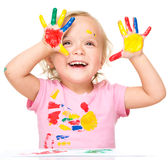 Portrait of a cute little girl playing with paints Stock Photography