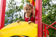 Portrait of cute little girl playing on the playground Royalty Free Stock Image