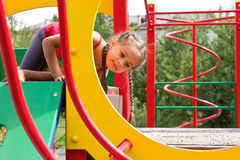 Portrait of cute little girl playing on the playground Royalty Free Stock Photos
