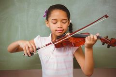 Portrait of cute little girl playing violin royalty free stock photos