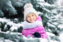 Portrait of cute little girl. In winter park Stock Photography
