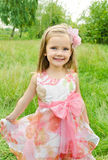 Portrait of cute little girl in princess dress. Outdoor portrait of cute little girl in princess dress royalty free stock photography