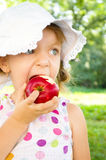 Portrait of a little girl with apple. Portrait of a cute little girl with red apple Royalty Free Stock Image