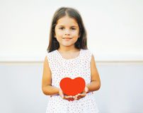 Portrait of cute little girl with red paper heart Royalty Free Stock Photo