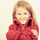 Portrait of a cute little girl in red sweater Stock Images
