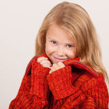 Portrait of a cute little girl in red sweater Royalty Free Stock Photography