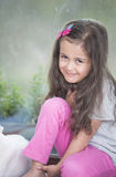 Portrait of cute little girl relaxing at home Stock Photo
