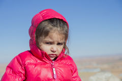 Portrait of cute little girl sadly looking at camera Royalty Free Stock Photography