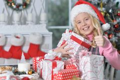 girl in Santa hat with gifts Royalty Free Stock Photography