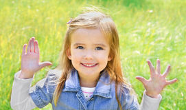 Portrait of cute little girl showing her fingers Royalty Free Stock Photos