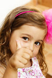 Portrait of cute little girl showing thumbs up Royalty Free Stock Image