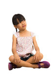 Portrait of a cute little girl sitting on floor Royalty Free Stock Photo