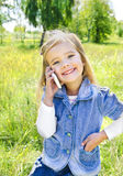 Portrait of cute little girl speaking by phone. Outdoor portrait of cute little girl speaking by phone Stock Photos