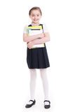 Portrait of a cute little girl standing with tablet. royalty free stock image