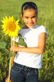 Portrait of a cute little girl with sunflower Stock Images