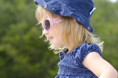 Portrait Cute little girl with sunglasses Stock Photos