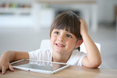 Portrait of cute little girl with tablet Stock Photo