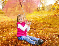 Portrait of cute little girl with umbrella Royalty Free Stock Image