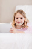 Portrait of a cute little girl using a tablet computer Royalty Free Stock Image